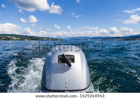 Small motor boat engine close up at full speed on lake Zurich sunny day #1429264943