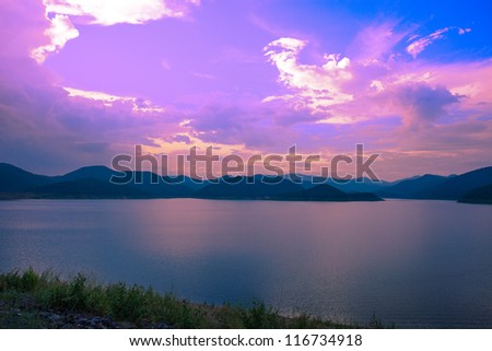 small mountain lake in the evening