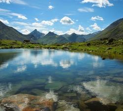 Small mountain lake in Ural mountains, Yugyd Va National Park, Near-Polar Ural, Russia.
