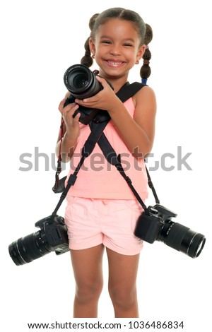 Small multiracial girl carrying three professional cameras - Isolated on white