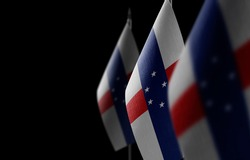 Small national flags of the Netherlands Antilles on a black background