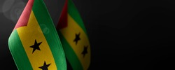 Small national flags of the Sao Tome and Principe on a dark background