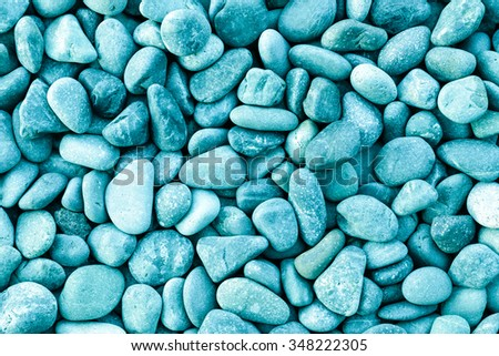 Small naturally polished green or blue rock pebbles background - Shutterstock ID 348222305