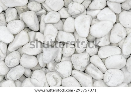Small naturally polished white rock pebbles background