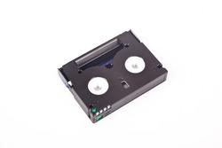 Small old black MiniDV format video cassette, isolated on white background