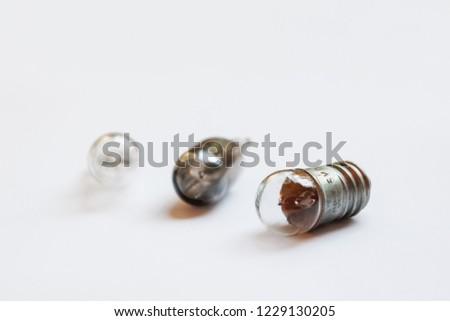 Small old light bulbs. Three incandescent lamps on white background.
