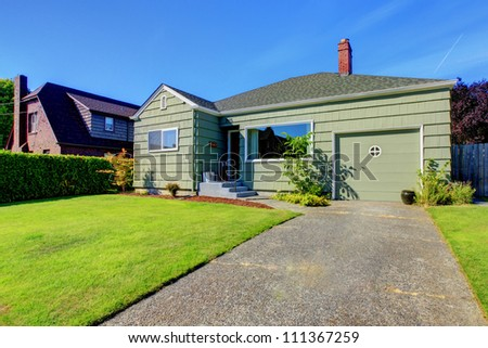 Small one story house with garage and driveway.