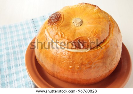 Small orange pumpkin, baked whole with vegetables