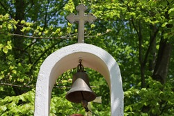 small orhodox church belfry in the forest
