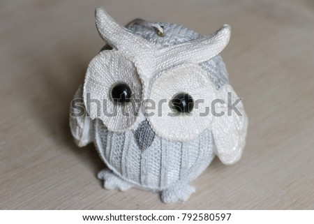 Small owl figurine close-up from above. Contemporary decor, minimalist decor, simplicity, home style, lagom, danish style, interior design, lifestyle content, homemade gifts, modern style etc. #792580597