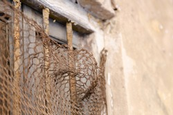 Small oxide bars covering an old window