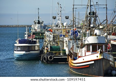 Small Pacific Harbor - Washington State, U.S.A. Small Aged Boats. Fishing Industry Photo Collection.