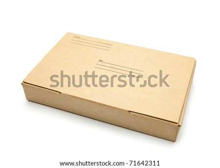 Small packet of brown card board box with address and sender space. - stock photo