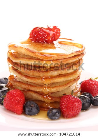 Small pancakes topped with honey