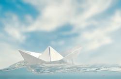 Small paper boat at sea