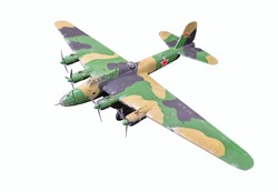 Small paper model of Soviet aircraft (long-range heavy bomber) of World War II painted with cryptic mimicry (low-visibility finish). Closeup. Selective focus