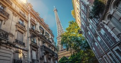 small paris street rue de l'université with view on the famous paris eiffel tower on a sunny day with some sunshine
