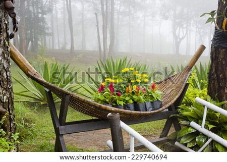 Small Park decorate with colorful flowers and rattan container. Garden design and decoration.