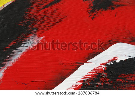 Small part of painted metal wall with  black,red and white paint  - Colourful abstract background-Close up 2
