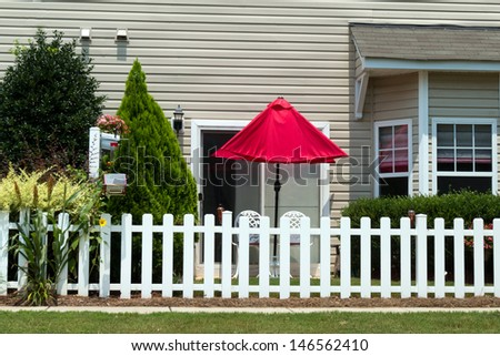 Small patio with red umbrella