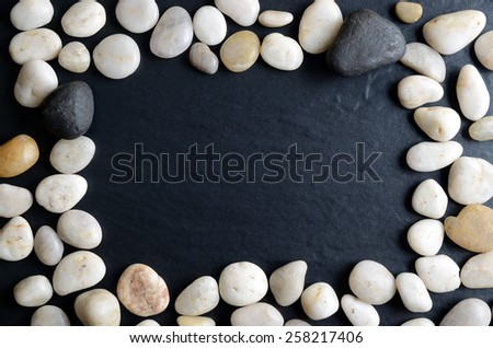Small pebbles on a dark background