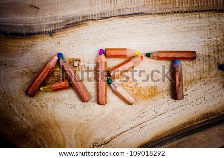 Small pencil on a wooden board