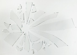 Small pieces of broken glass on a white surface