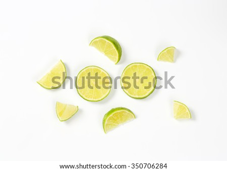 small pieces of fresh lime on white background #350706284