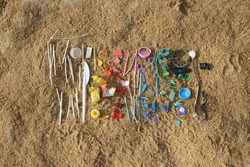 Small pieces of plastic found at the beach are arranged in a colorful way.