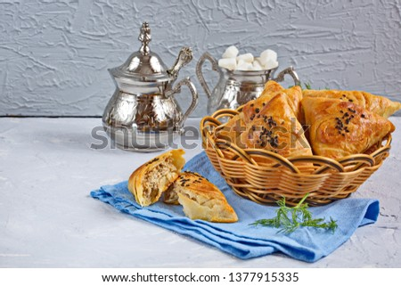 Small Pies With Meat Samsa - Oriental Cuisine. Meat dish of the peoples of Central and Central Asia, dough, meat and onions, suitable for the Nauryz or Navruz holidays,  #1377915335