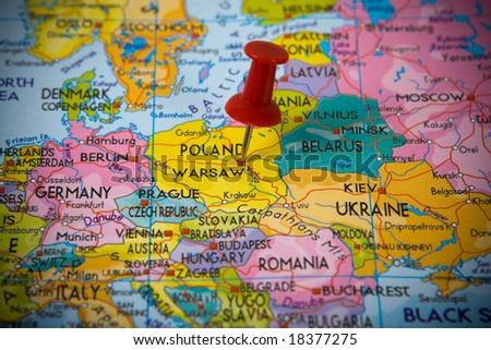 Small pin pointing on Warsaw (Poland)  in a map of Europe