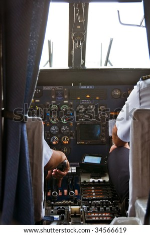 Small Plane Cockpit with Crew Preparing for Take-off