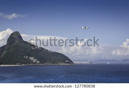 Small plane flying over Rio De Janeiro, Brazil