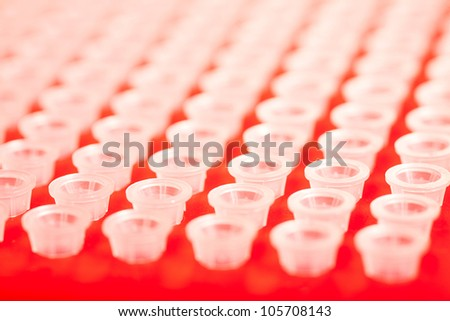 small plastic tubes in the rack - stock photo