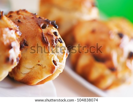 Small plates of muffins on background of green summer garden.