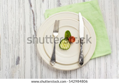 Small portion of food. Anorexia or unhealthy diet concept. Top view