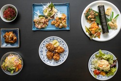 small portions of Japanese food over the table from above