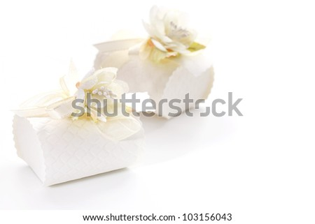 Small present box decorated with flower in white