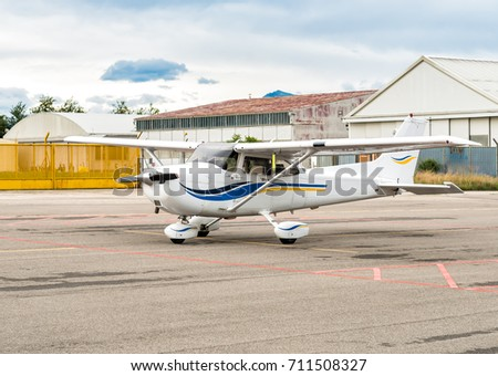 Small private airplane Cessna parked at a small airport