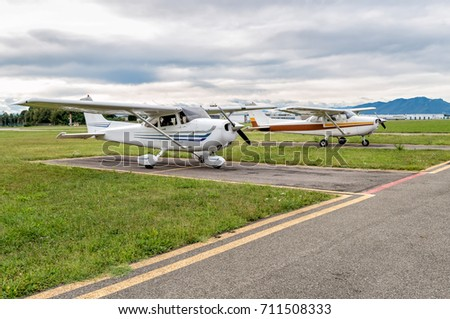 Small private airplanes Cessna parked at a small airport