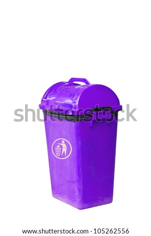 Small purple garbage bin with black garbage bag - stock photo