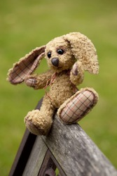 small rabbit soft toy sitting in an iron bench, Author's work with property release