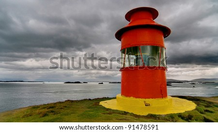 Small red lighthouse on a cloudy day at Stykkisholmur, Snaefellsnes peninsula, Iceland.