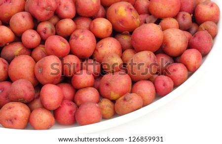 Small Red Potatoes on a bowl over white background