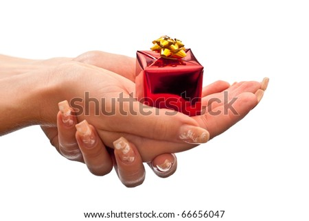 Small red present in woman's hands. Isolated on white