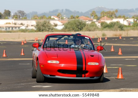 small red sports car competing in auto cross