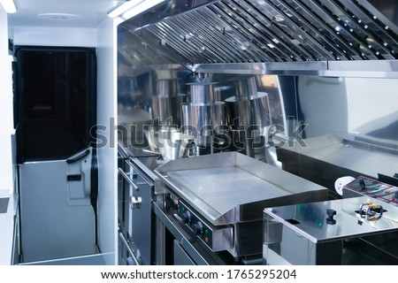 Small restaurant kitchen. Empty restaurant kitchen with new equipment. Industrial electric frying pan and deep fryer. Concept - sale of restaurant equipment. Cafe is empty due quarantine. Bankruptcy
