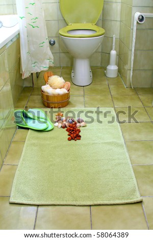Small retro bathroom with green tiles