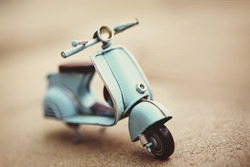 Small retro scooter toy, toned sepia
