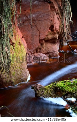 small river scene among rocky valley - stock photo